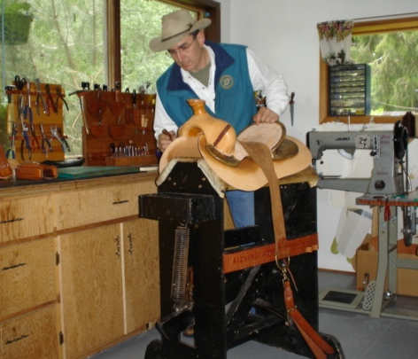 Reg working on a custom handmade saddle in his shop